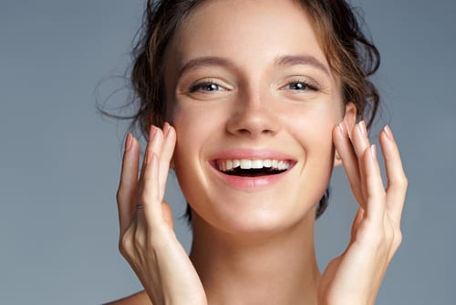beautiful brunette girl touching her face-img-blog