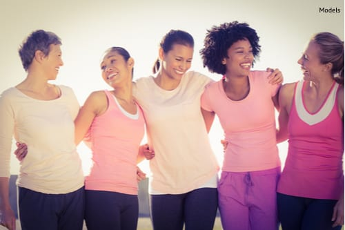 Laughing women wearing pink in a park-img-blog