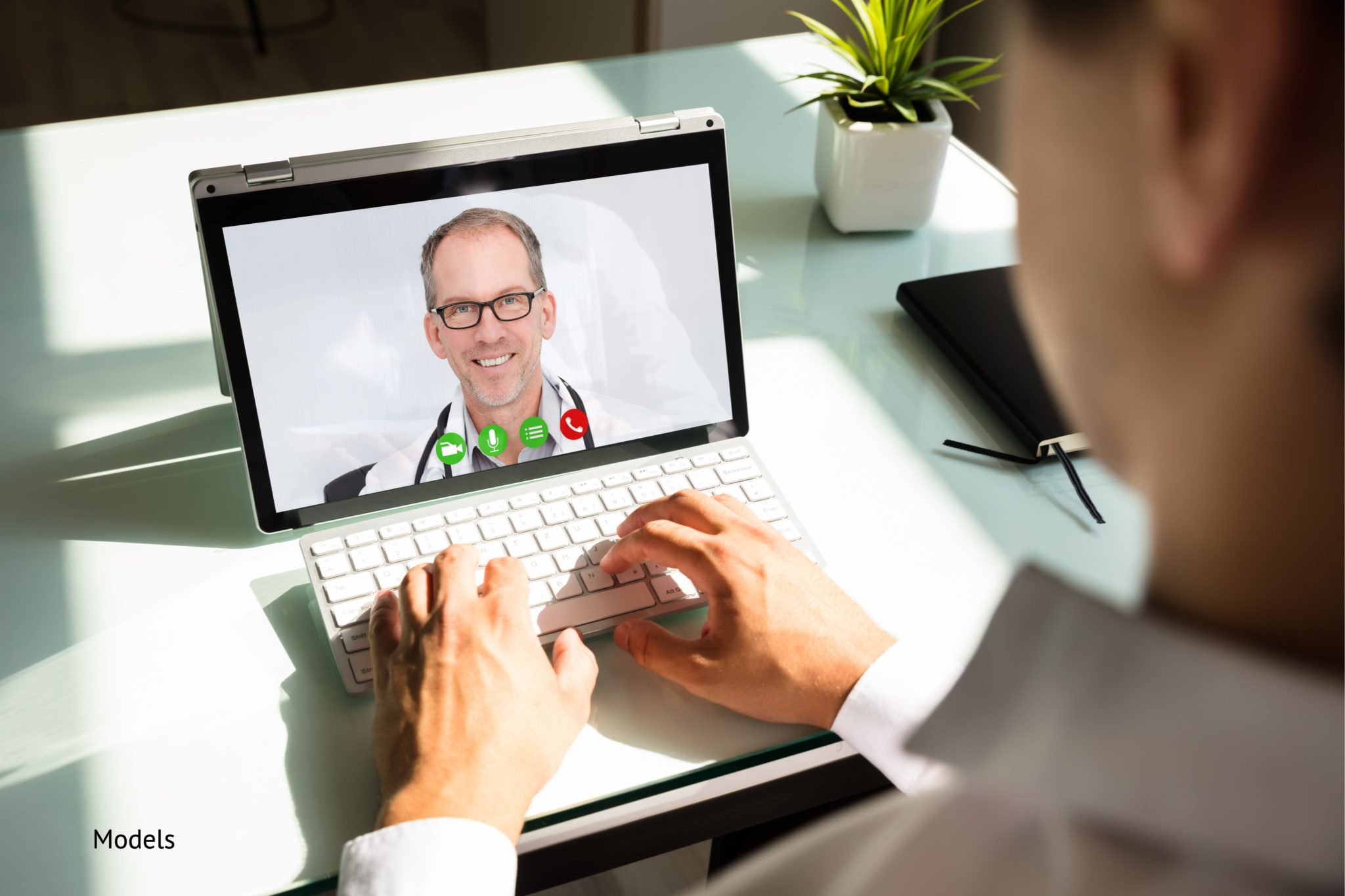 Man suing his laptop for an appointment with a doctor using telemedicine
